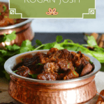 Instant Pot Rogan Josh in a copper dish with whole spices and cilantro in background