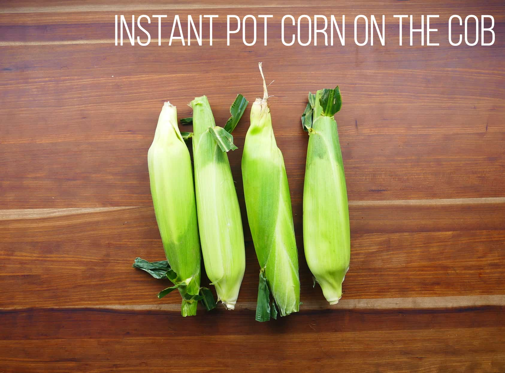 Instant Pot corn on the cob - four ears of corn in husk