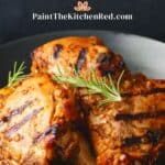 Instant pot peri peri chicken paintthekitchenred dot com - Grilled peri peri chicken pieces stacked in black plate on blue and white napkin with rosemary garnish